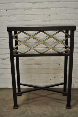 Custom iron console table by Ferro Designs LLC with a dark iron base and a tile top.