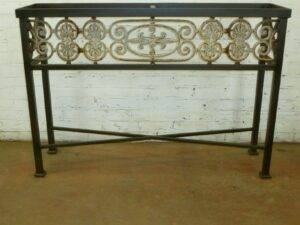 Custom iron console table by Ferro Designs LLC with a dark iron finish.