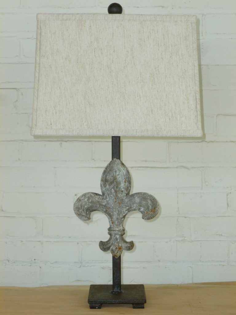 Ferro Designs LLC fleur-de-lis custom iron table lamp with a gray, distressed finish and a dark iron base. Paired with a 14 inch rectangle linen lamp shade.