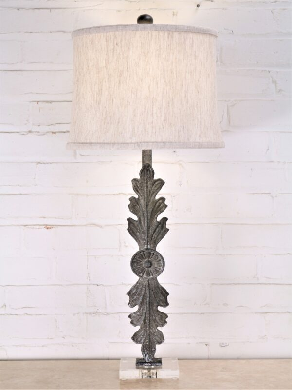 Leaf custom iron table lamp with a gray, distressed finish on an acrylic base. Paired with a 12 inch linen drum lamp shade.