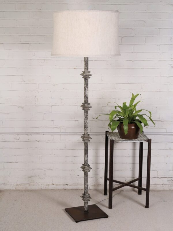 Custom iron floor lamp with a gray, distressed finish and a dark iron base. Paired with a 19 inch linen drum lamp shade.