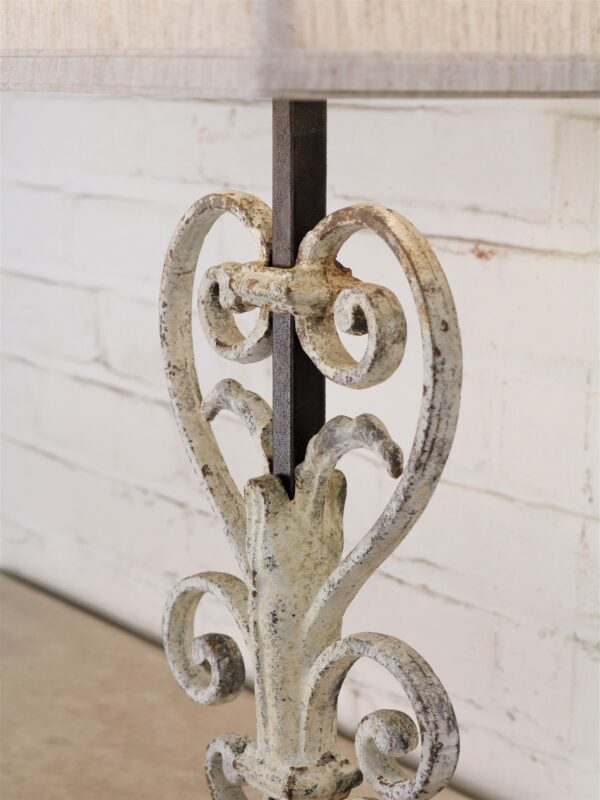 Heart scroll custom iron table lamp with white, distressed finish on dark iron base