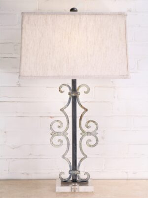 Scroll custom iron table lamp with white, distressed finish on an acrylic base