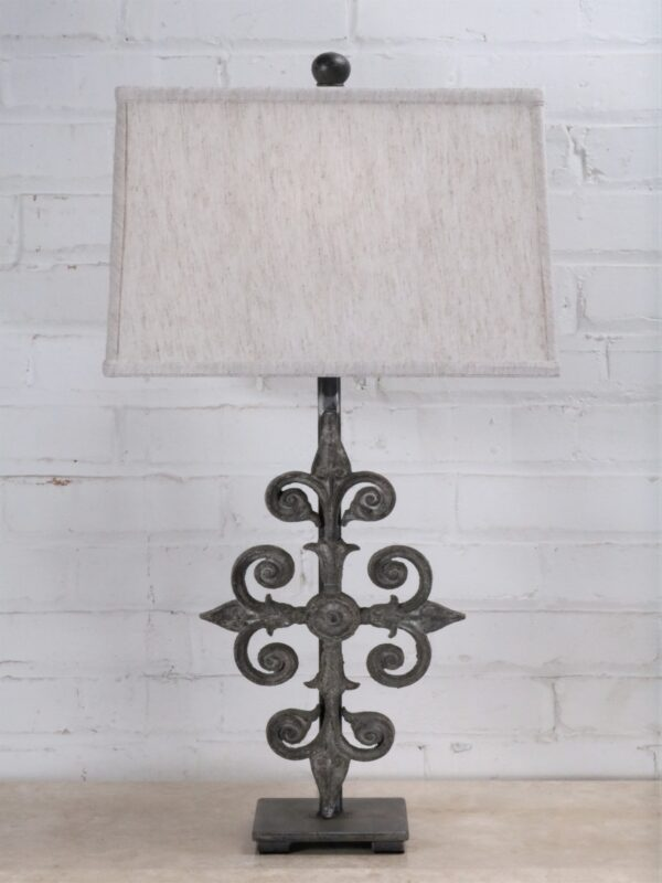 Cross custom iron table lamp with a gray, distressed finish on a pewter base