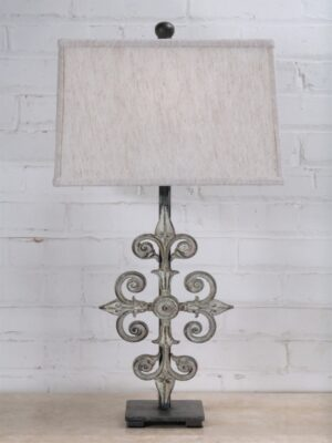 Cross custom iron table lamp with a white, distressed finish on a pewter base