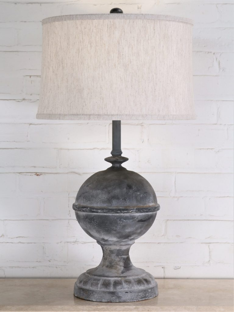 Finial custom iron table lamp with a gray, distressed finish and paired with a 15 inch linen drum lamp shade.