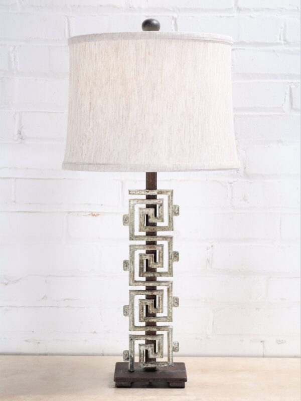 Meandros-greek key custom iron table lamp with a white, distressed finish and a dark iron base. Paired with a 12 inch drum linen lamp shade.