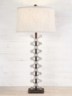 X post custom iron table lamp with a white, distressed finish and a dark iron base. Paired with a 15 inch linen drum lamp shade.