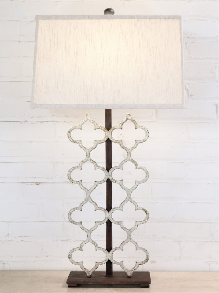 Quatrefoil custom iron table lamp with a white, distressed finish and a dark iron base. Paired with a 17 inch rectangle linen lamp shade.