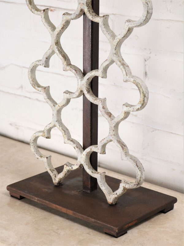 Quatrefoil custom iron table lamp with a white, distressed finish and a dark iron base.
