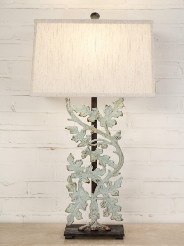 Oak leaves custom iron table lamp with a patina green finish and a dark iron base. Paired with a 16 inch rectangle linen lamp shade.