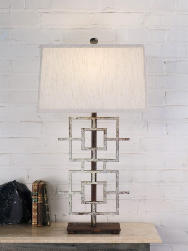 Squares custom iron table lamp with a white, distressed finish and a dark iron base. Paired with a 16 inch rectangle linen lamp shade.