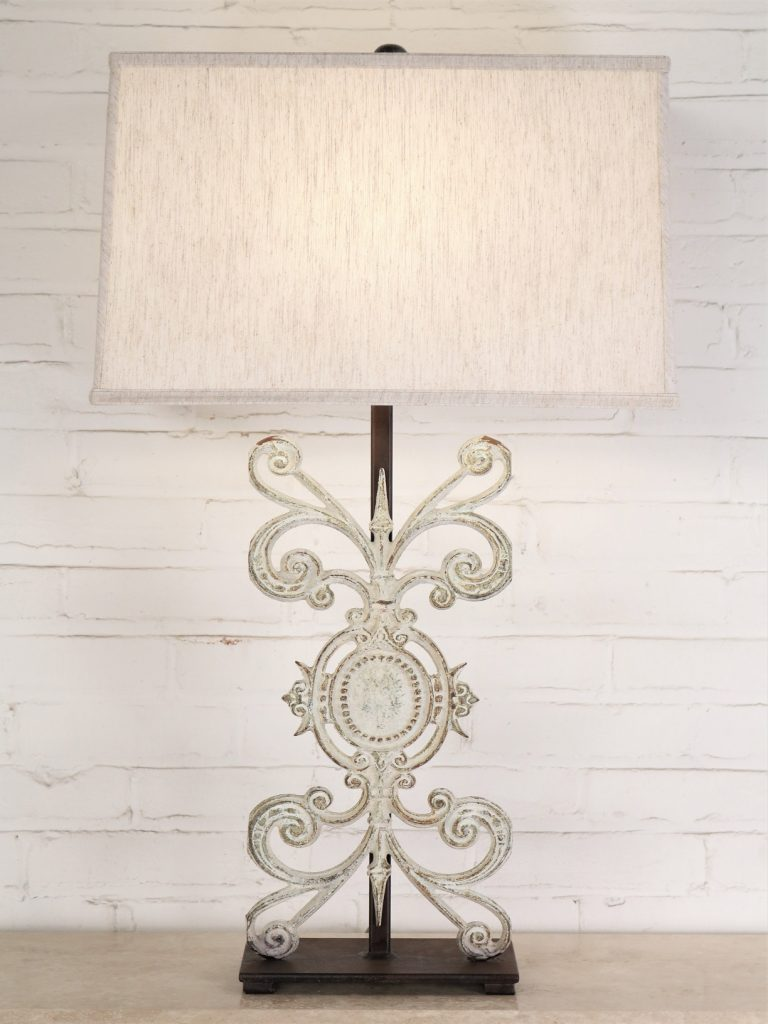 Medallion custom iron table lamp with a white, distressed finish and a dark iron base. Paired with a 19 inch rectangle linen lamp shade.