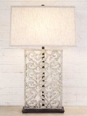 Scrollwork custom iron table lamp with a white distressed finish and a dark iron base. Paired with a 19 inch rectangle linen lamp shade.