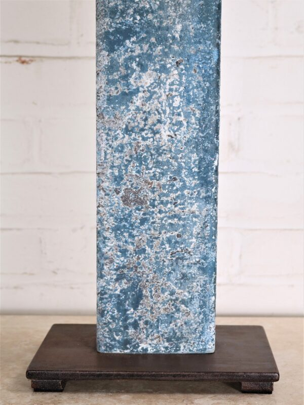 Rectangle post custom iron table lamp with a blue, distressed finish and a dark iron base.
