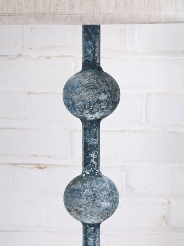 Sphere custom iron table lamp with a blue, distressed finish.