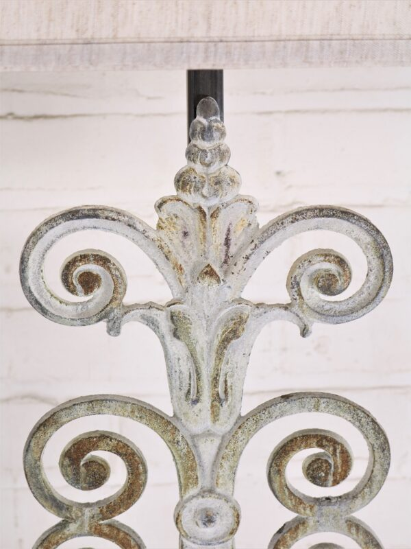 Fleur Scroll custom iron table lamp with a white, distressed finish.