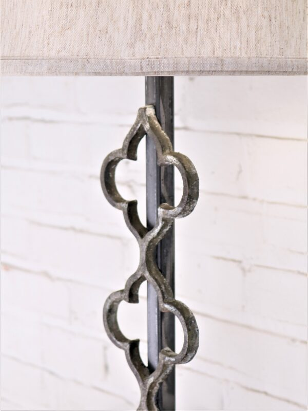 Quattuor custom iron table lamp with a gray, distressed finish.