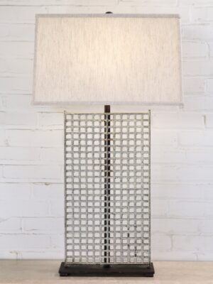 Grid custom iron table lamp with a white distressed finish and a dark iron base. Paired with a 19 inch rectangle linen lamp shade.