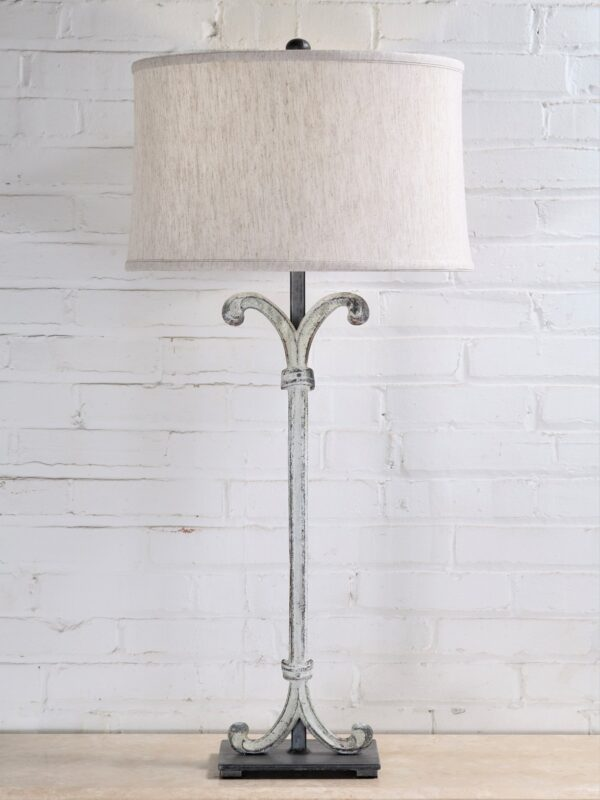 Scroll column custom iron table lamp with a white, distressed finish and a pewter base. Paired with a 17 inch linen drum lamp shade.
