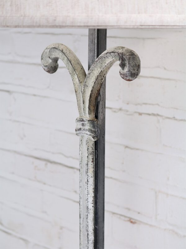 Scroll column custom iron table lamp with a white, distressed finish.