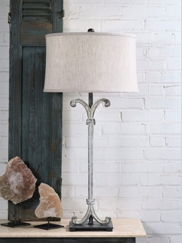 Scroll column custom iron table lamp with a white, distressed finish and a pewter base. Paired with a 17 inch linen drum lamp shade and selenite crystal decor.