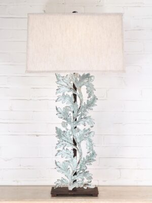 Large oak leaves custom iron table lamp with a patina green, distressed finish and a dark iron base. Paired with a 19 inch rectangle linen lamp shade.