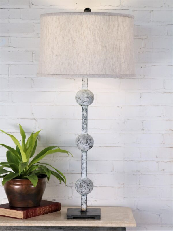 38 inch tall sphere custom iron table lamp with a white, distressed finish and a pewter base. Paired with a 17 inch drum linen lamp shade.