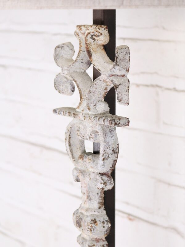 Corinthian column custom iron table lamp with a white, distressed finish.