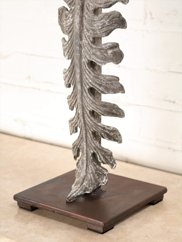 Large leaf custom iron table lamp with a gray, distressed finish and a dark iron base.
