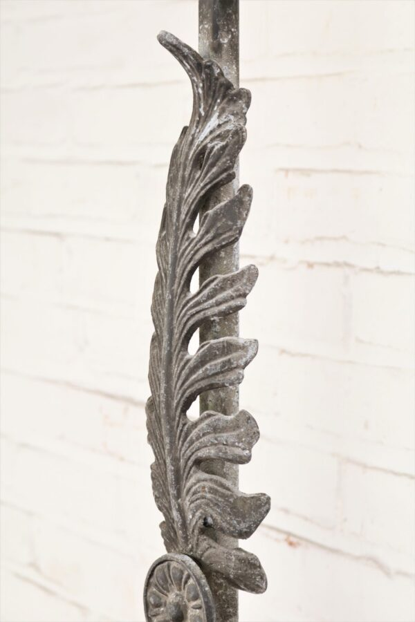 Large leaf custom iron table lamp with a gray, distressed finish.