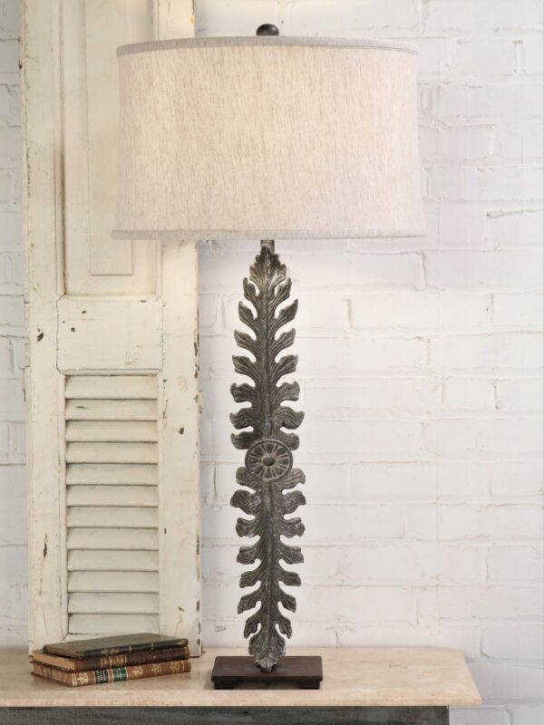 Large leaf custom iron table lamp with a gray, distressed finish and a dark iron base. Paired with a 19 inch linen drum lamp shade.
