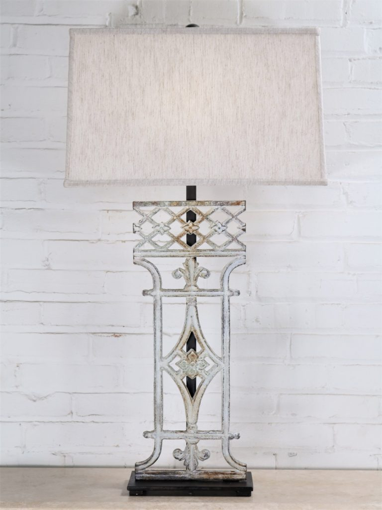 French custom iron table lamp with a white, distressed finish and a dark iron base. Paired with a 19 inch rectangle linen lamp shade.