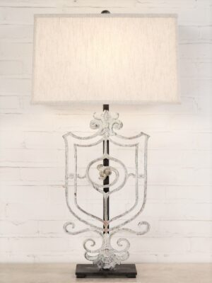 Crest custom iron table lamp with a white, distressed finish and a dark iron base. Paired with a 19 inch rectangle linen lamp shade.