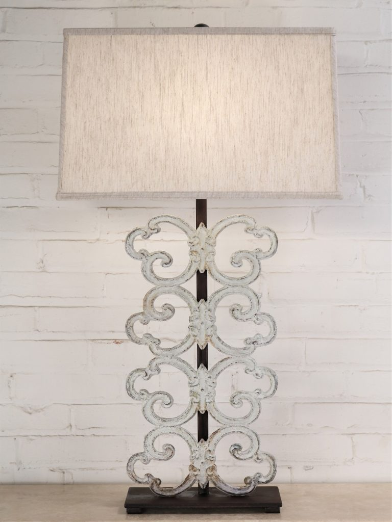 Palmetto custom iron table lamp with a white, distressed finish and a dark iron base. Paired with a 19 inch rectangle linen lamp shade.