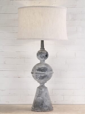 Large finial custom iron table lamp with a gray, distressed finish. Paired with a 19 inch linen drum lamp shade.