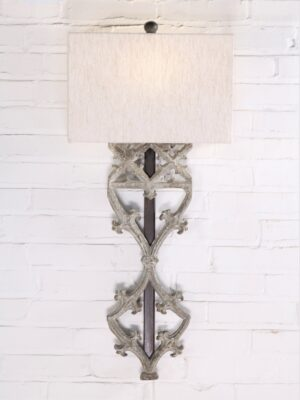 Gothic style custom iron wall sconce with a gray, distressed finish. Paired with a half rectangle linen lamp shade.