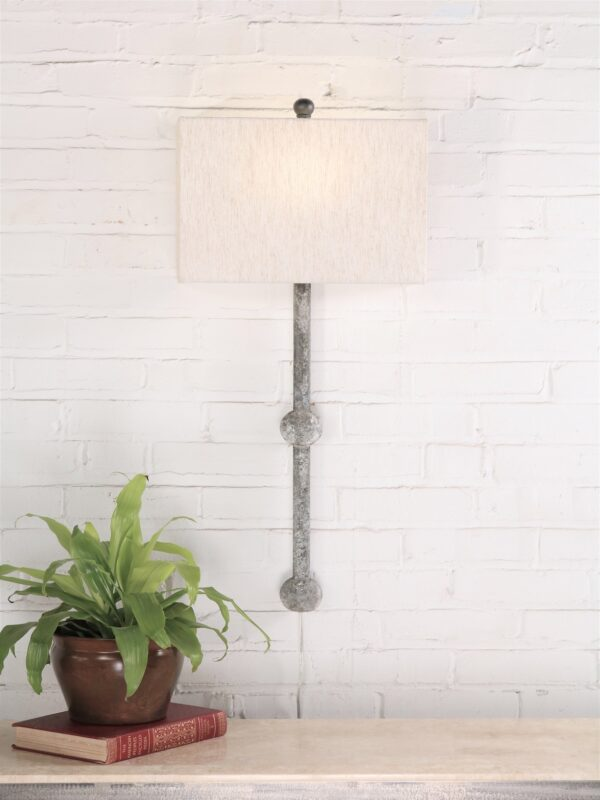 Small sphere custom iron wall sconce with a gray, distressed finish. Paired with a half rectangle linen lamp shade.