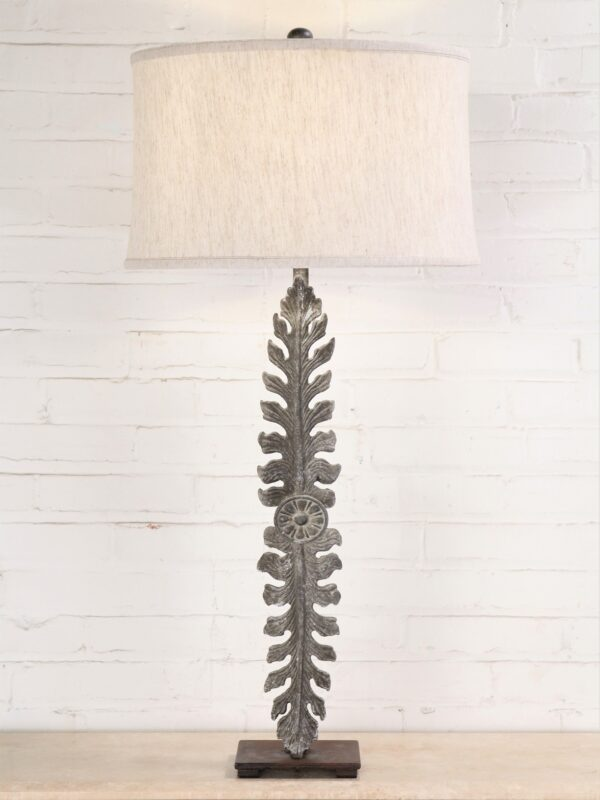 Large leaf custom iron table lamp with a gray, distressed finish and a dark iron base. Paired with a 17 inch linen drum lamp shade.