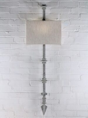 Square collar custom iron wall sconce with a gray, distressed finish. Paired with a half rectangle linen lamp shade.