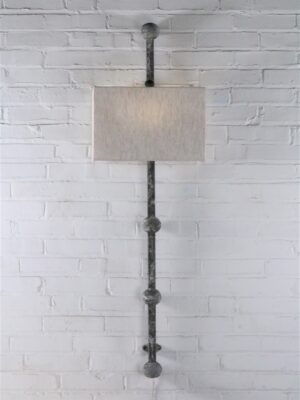 Spheres custom iron wall sconce with a gray, distressed finish. Paired with a half rectangle linen lamp shade.