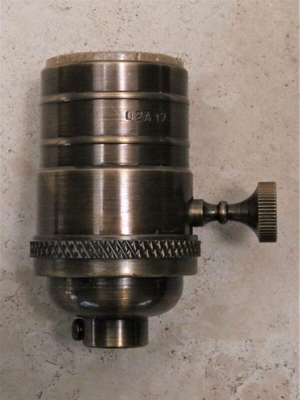 Replacement lamp socket in dark bronze.