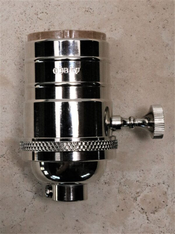 Replacement lamp socket in nickel.