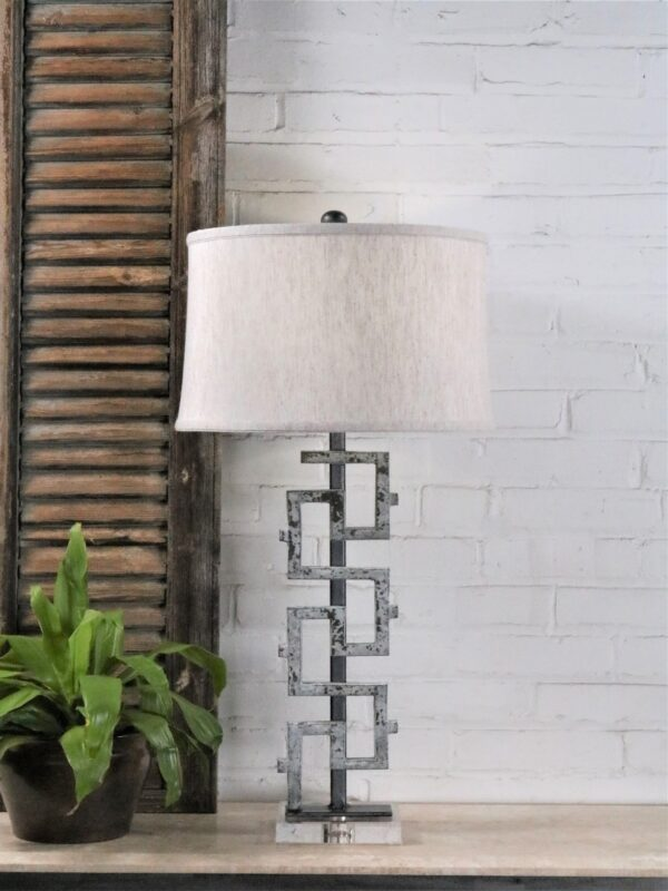 Antique iron table lamp by Ferro Designs LLC with a white, distressed finish and an acrylic base. Paired with a 15 inch linen drum lamp shade.