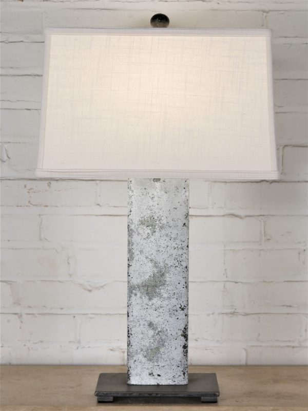 27 inch tall rectangle post custom iron table lamp with a white distressed finish and a dark iron base. Paired with a 16 inch rectangle linen lamp shade.