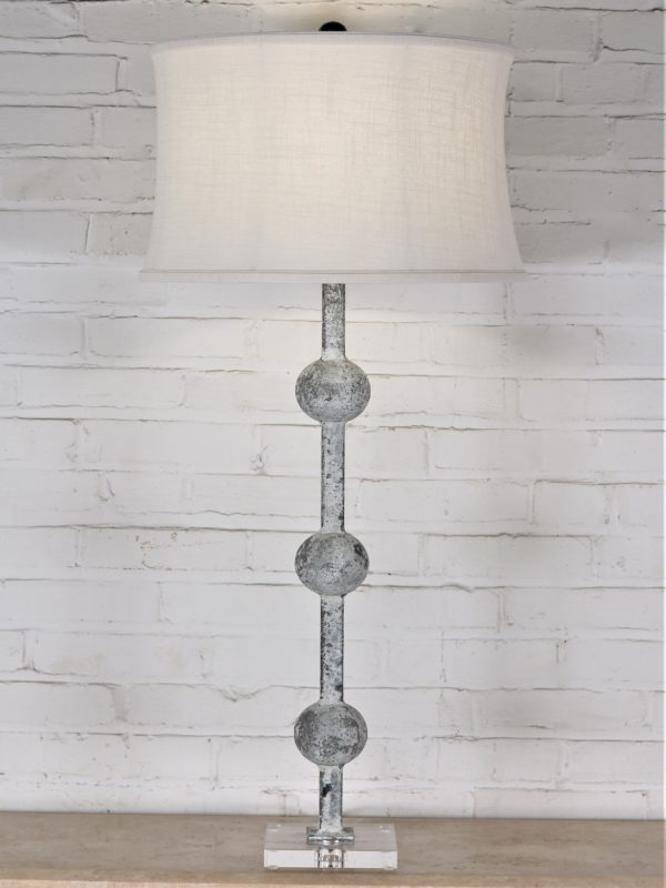 38 inch tall spheres custom iron table lamp with a white, distressed finish and an acrylic base. Paired with a 17 inch drum linen lamp shade.