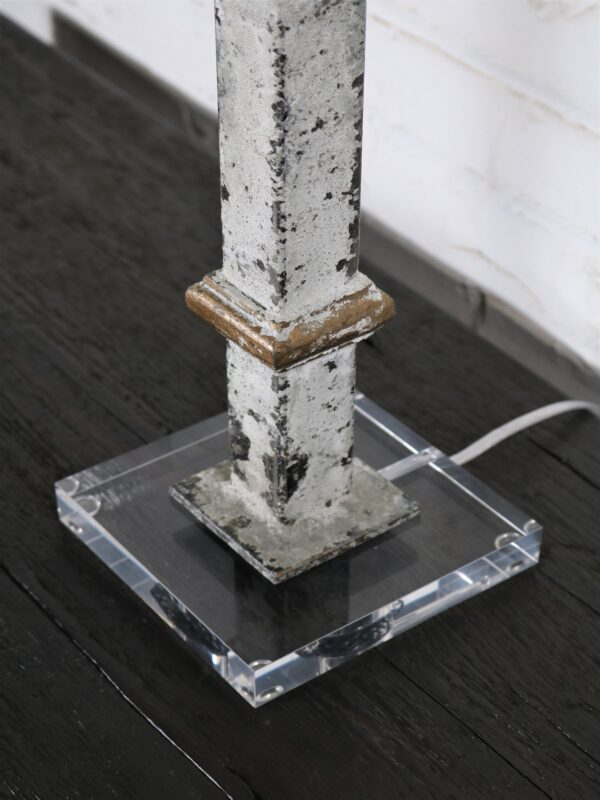 White metal table lamp with gold accents and an acrylic base.